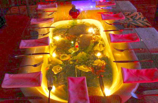 Dining Table Bathtub Fishtank At Fallen Angel
